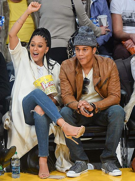 Star Tracks: Monday, January 5, 2015 | CHEERING SECTION  | Tia Mowry does a cheer for the home team as she and her husband Cory Hardrict enjoy the Los Angeles Lakers game against the Memphis Grizzlies at Staples Center in Los Angeles on Friday.