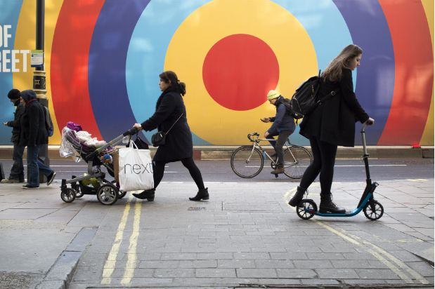This Nick Turpin Street Scene image was taken in Oxford Street, London. Again I like how linked this photo feels due to the circles, and how they reoccur on the walls, and wheels of those who move past. It is these links and similarities that really turn the image into something interesting and pleasing to look at. The bright colours of the wall as well as the wheels I feel also add a fun playful feel to the image, which is a really nice thing to explore.