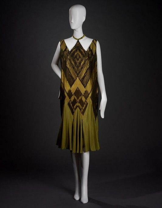 Evening Dress Metz. & Co., retailer Dutch, 1913 - 1981 Liberty of London, Inc., textile designer English, founded 1875 B. Altman Co., retailer American, 20th century Evening Dress, ca. 1924 silk; metallic yarn; glass beads; compound weave S84.123A