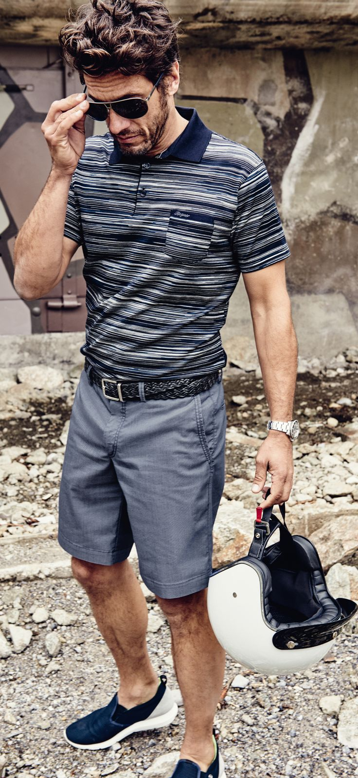 Still looking good, even without the bike. Classic-cut polo shirts with modern striping patterns and classy-yet-comfortable shorts come together for a cool summer look from the Bogner Man Spring/Summer 2016 collection.