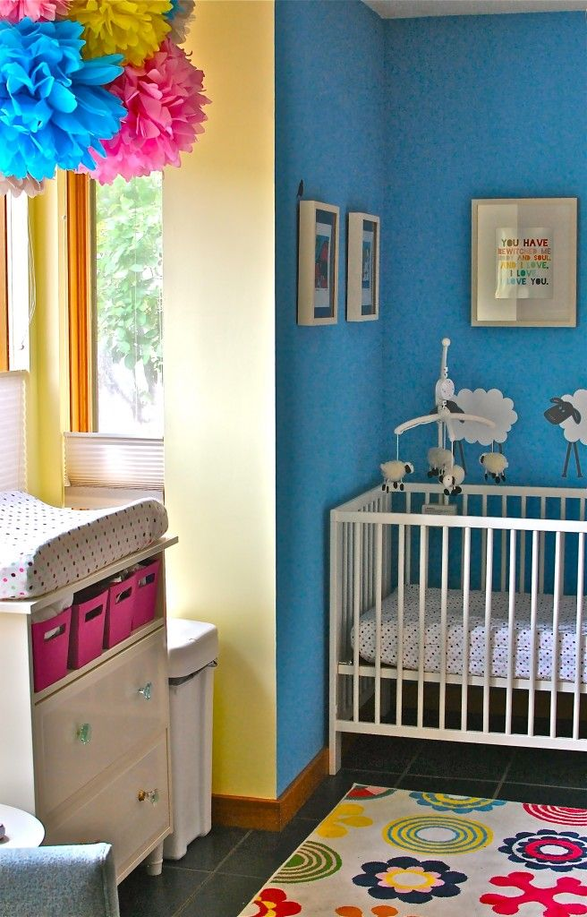 Kind of liking this one with the nice bright colours.    http://projectnursery.com/projects/nursery-in-living-room-of-one-bedroom-condo/#