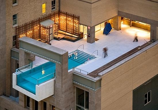 World's Most Extraordinary Swimming Pools - The Joule Hotel in Dallas - The twisting swimming pool projects eight feet over the sidewalk, at the edge of the 10thfloor.