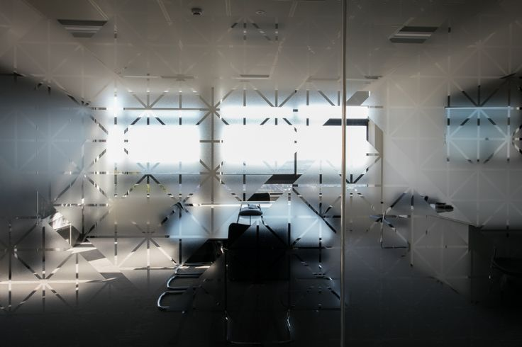 Window glass partition in office. Glass graphic. Window film. Geometric shapes on glass. Workplace glass partition designs by Interaction.
