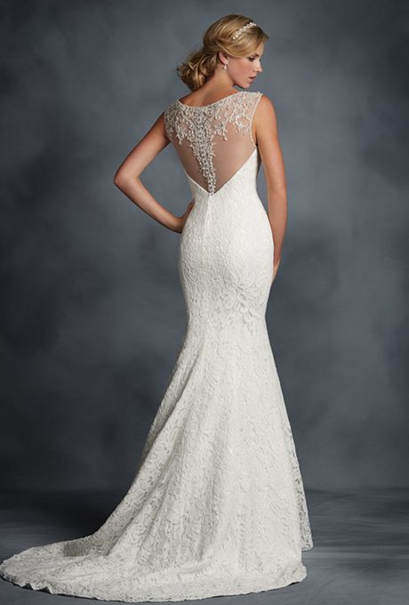 Brides: The Alfred Angelo Collection. Figure-flattering allover lace fit-and-flare gown with a deep sweetheart neckline adorned with glamorous silver and crystal beading. Accented with a sheer back yoke that has been embellished throughout with matching beading and covered button closure. The soft flared skirt finishes with a chapel length train.