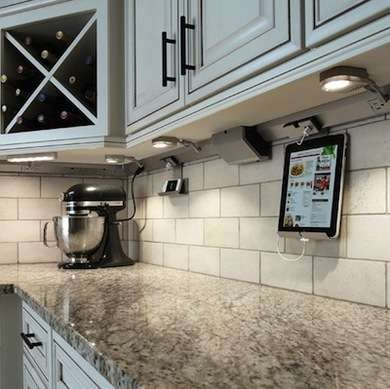 Under counter mounted outlets so that the tile pattern isn't interrupted.