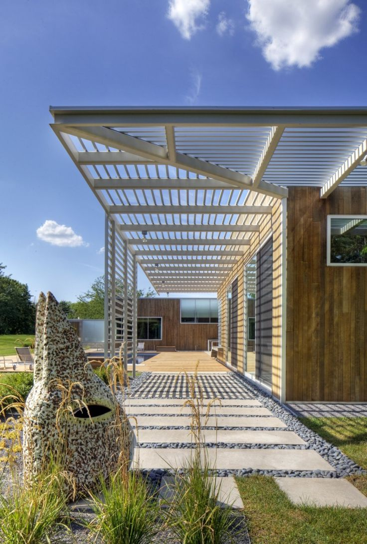 TACKarchitects have designed the ART[house] in Omaha, Nebraska.  wood siding, brise soleil screen, modern clean warm