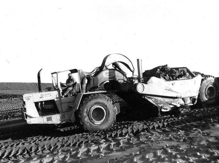 Wabco C229F at work on a major railroad realignment job in Colorado, USA in 1970. Unlike a lot of other scrapers, the operator did not sit over the left wheel which gave a much smoother ride. The C229F did, however, have a tendency to nose dive during a turn if you weren't careful. The owner has placed a metal plate just above the bumper to prevent earth from penetrating the radiator.