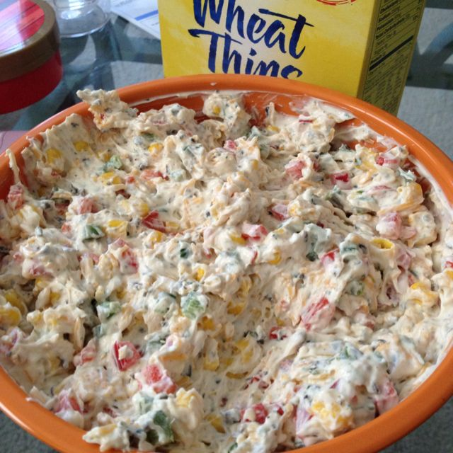 Pool-side dip: 1 red pepper, 2 jalepenos (seeded/chopped), 1 can of corn (drained), 1/2 can diced blk olives, 16 oz cream cheese (softened), and 1 packet Hidden Valley Ranch dip seasoning mix. Serve with crackers or Fritos Scoops