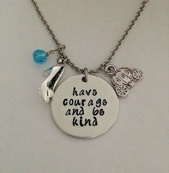 This Cinderella movie inspired necklace is stamped on a 1 aluminum pendant. It is stamped with Have courage and be kind. It comes with a