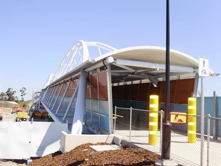 Curved profile Ritek Roof panel for this access bridge.
