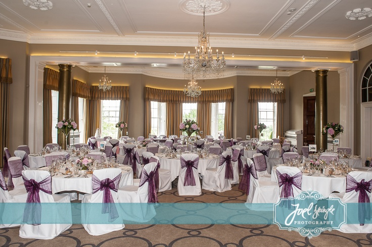 Aubergine organza sash on white chair covers at Rudding Park