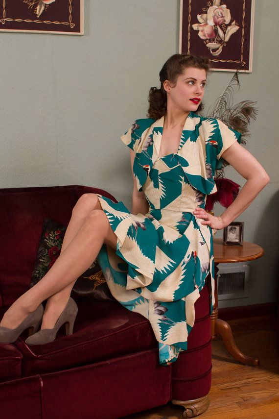 A rare late 1940s rayon hawaiian sarong dress, in one of the most striking prints and colors I have ever seen in one of these pieces. Made by Kathleens