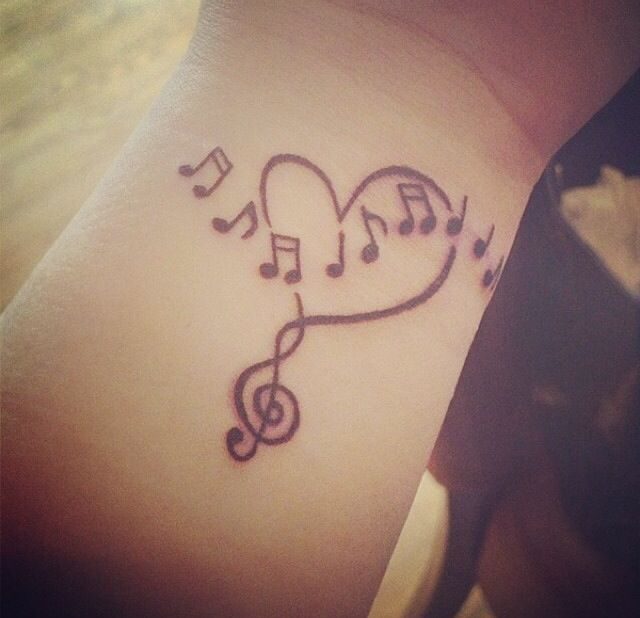 Music tattoo...I would like to do this...!!