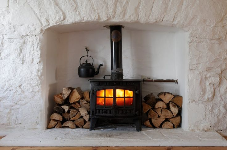 Irish cottage interior, painted stone inglenook with woodburner
