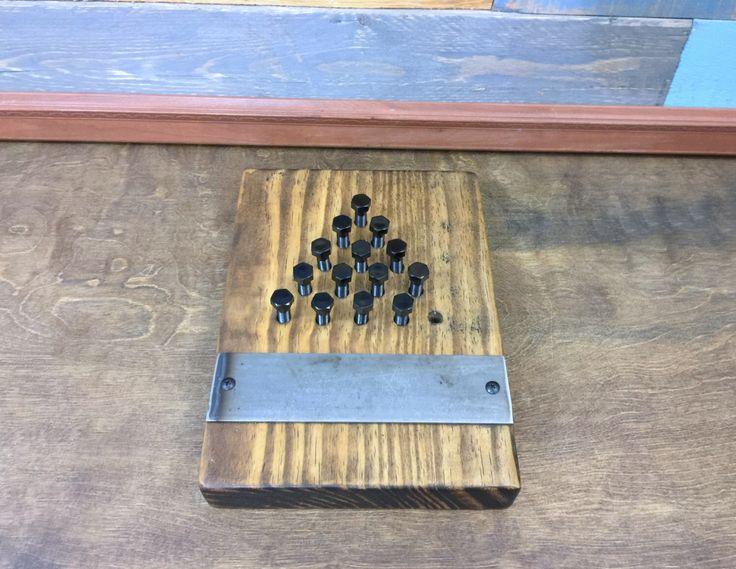 Industrial Style Triangle Peg Game, Last Man Standing Game, Game, Industrial Furniture, Triangle Game, Industrial Decor, Steampunk, Man Cave by TheCleverRaven on Etsy https://www.etsy.com/listing/507141645/industrial-style-triangle-peg-game-last