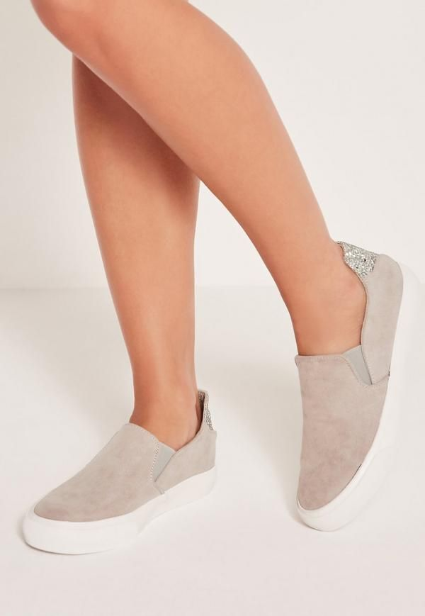 We're all about that glitter and these sneakers are ready to give a flashy statement. In a luxe faux suede fabric, skater sneak style and a silver glitter tab, these slip on beauts with a white contrasting sole will make sure you get your s...