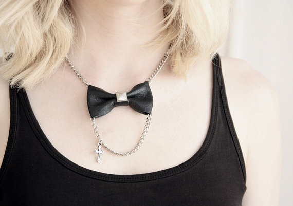 Necklace with leather bow and a little chain.