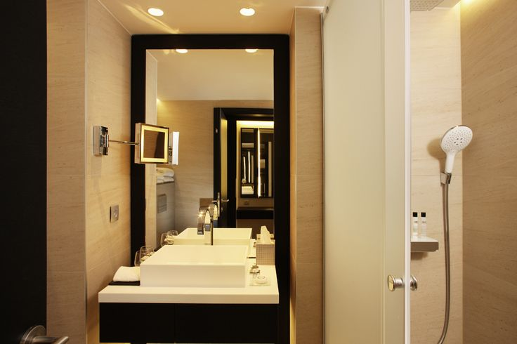 Superior Room: closed bathroom with shower