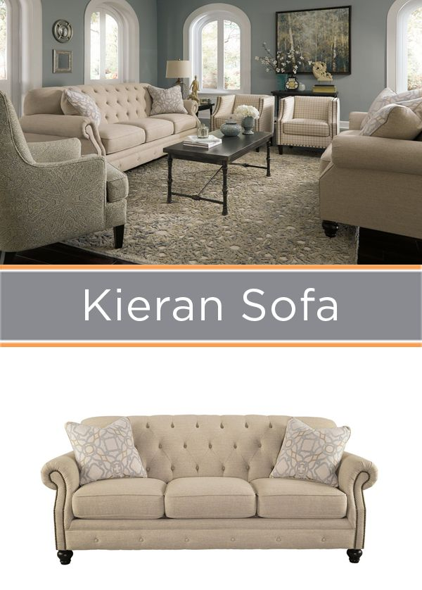 Create A Sophisticated Space With A Tufted Neutral Sofa.