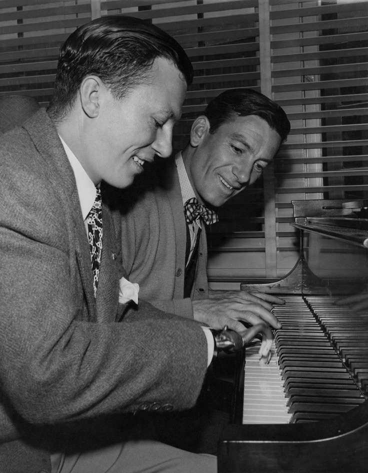 """In this scene from """"The Best Years of Our Lives,"""" HAROLD RUSSELL sits down to ping out a jazzy little duet with Hoagy Carmichael. Russell uses prosthetic hooks for hands and fingers that were lost when some TNT he was carrying accidentally exploded on an Army base. 1946  Note: as in the movie, Russell married his childhood sweetheart."""
