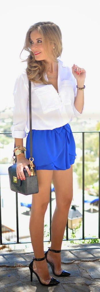 Adorable royal blue shorts with loose top and black pencil leather hand bag , black high heel sandals