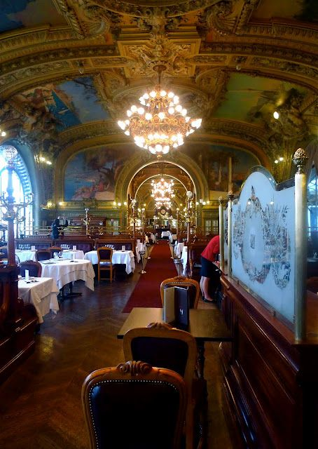"Paris-Lyon-Mediterranean (PLM) Company built the restaurant for the  1900 Exhibition. It was renamed ""Le Train Bleu"" in 1963 to celebrate the ""Paris-Vintimiglia"" line & granted historical monument status in 1972.  It's famous for the forty-one paintings, including landscapes traveled through by the PLM trains, waxed parquet flooring, wood panelling, and long, leather-upholstered wall-seats. Regulars have included Coco Chanel, Brigitte Bardot, Salvador Dali and Jean Gabin. [2nd of three pins]"