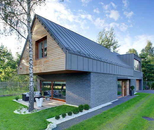 Фасады домов из бетона и дерева