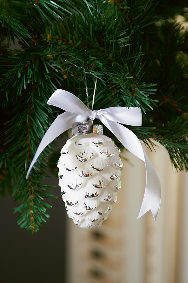Spray paint white code,add white bow and hang on tree.
