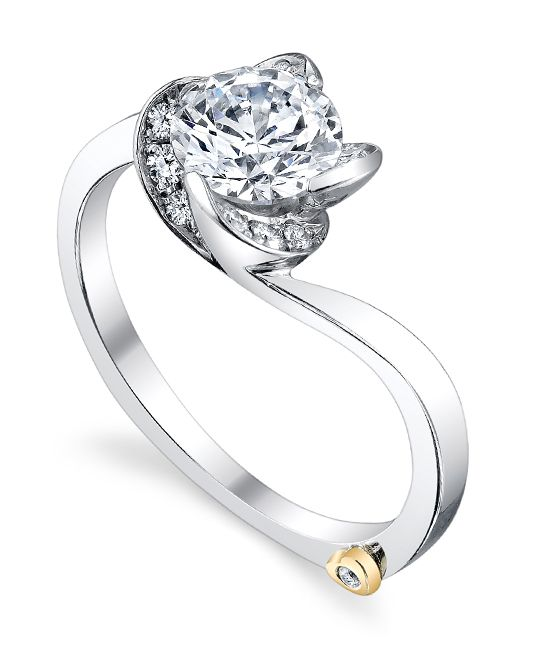 The Rose Engagement Ring Has Four Leaves Set With Side Diamonds That Wrap Around Center Stone Holding It Securely In Place And Creating Look Of A