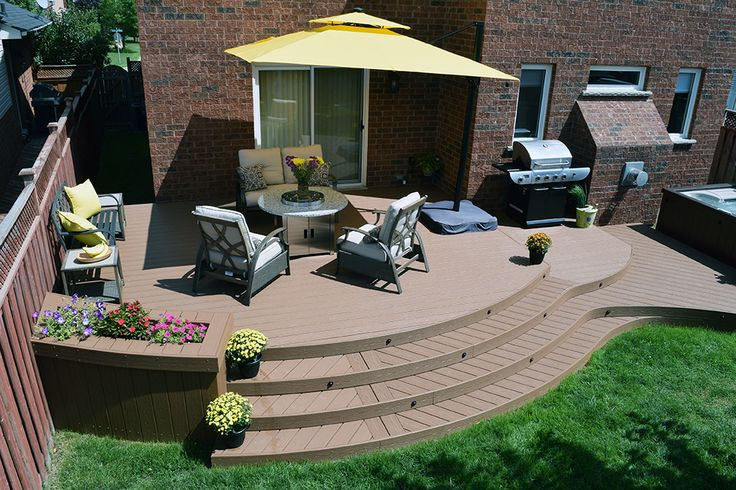 This curved low maintenance deck was built by Hickory Dickory Decks Durham using Fiberon composite decking.