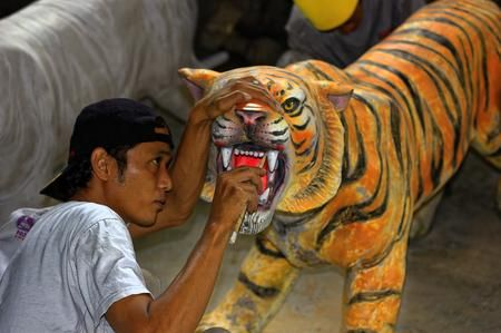 Cleaning Photo by Joko Apridinoto — National Geographic Your Shot - Sculpture Studio activity in Yogyakarta