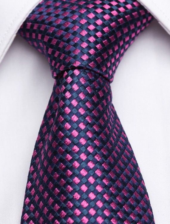Vellutino Piccolo Navy Blue Silk Tie with Fuschia Squares This navy-blue woven silk tie features a fine contrasting fuschia diamond check pattern that exudes superior artistry and craftsmanship. For an elegant, refined look, wear this tie with a solid colored dress shirt and a well-tailored suit. Whether you are conducting business or hitting the town, the Vellutino Piccolo tie will certainly add panache to your outfit! Shop and buy ties at http://www.shopties.com! #shopties