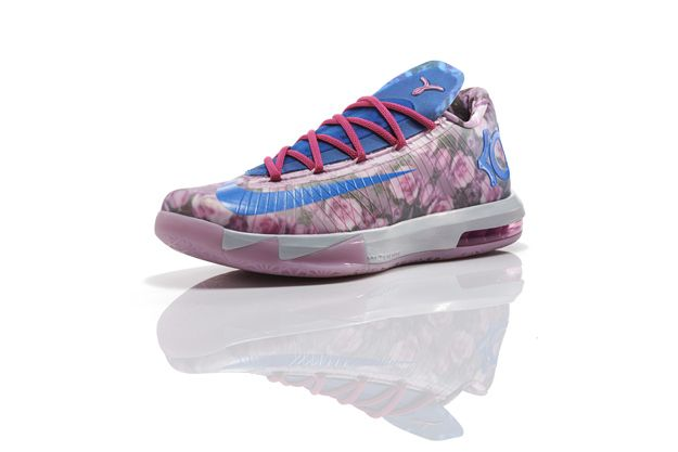 Kevin Durant's New Sneakers Pay Floral, Pastel Tribute To His Late Aunt-The sneaker's floral pattern is reminiscent of a robe she used to wear. The shoe features a Kay Yow Cancer Fund logo on the tongue, and proceeds will go toward the fight against women's cancers.<3