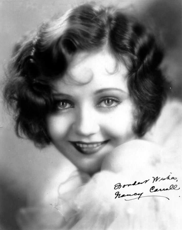 This doll-faced 1920's beauty Nancy Carroll is the definition of classic beauty, with her smoldering eyes and her flawless skin she radiates beauty. And I absolutely love her hair, its beautiful, and so inspiring! :)