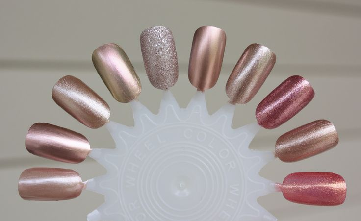 rose gold nail polish Left to Right: Sally Hansen Nude Shimmer * Pantone Rose Dawn * Butter London Champers * Deborah Lippmann Sugar Daddy * Orly Rose Pixel * Essie Penny Talk * Orly Rage * Hard Candy Pink Crush * Kure Bazaar Or Rose * Zoya Tinsley