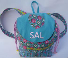 SAL noël,SAL sac à dos, tuto sac à dos, tuto sac à dos maternelle,tuto sac à dos enfant,sac à dos personnalisé,sac personnalisé, pochon personnalisé,sac à dos rabat enfant,bohème,sac à dos fille,sac à dos garçon,fleur de lotus,un lotus bleu