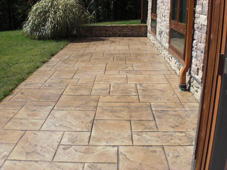 Stamped Concrete Patio Was Restored With A Brown Tinted