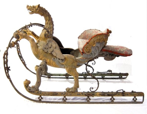 Magnificent baroque wood and wrought iron sleigh made for the Dauphin, with original light green paint and original oil gilding. The body of the sleigh is in the form of a brilliantly carved dragon-headed chimère, with eagle wings and a lion's body, rearing up on his hind legs.