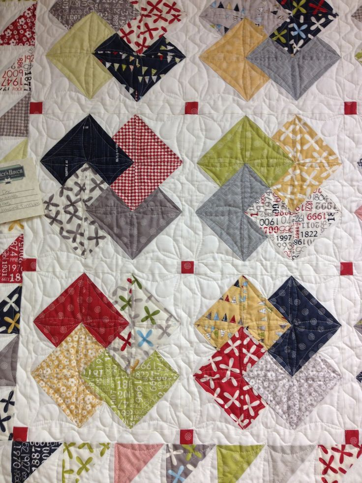 Card Trick....I love the bits of red in the white background - this would make a great pillow for a small quilt project