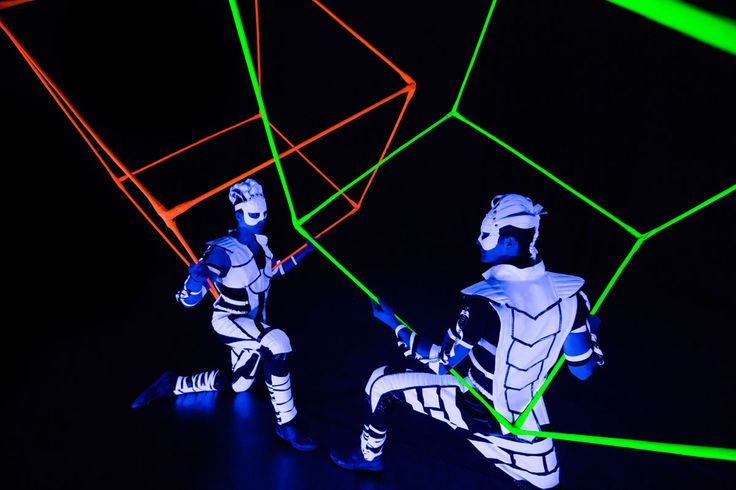 Acrobatics with cubes in black light show. Crystal Light Show - Anta Agni. http://antaagni.com/crystal-light-show/