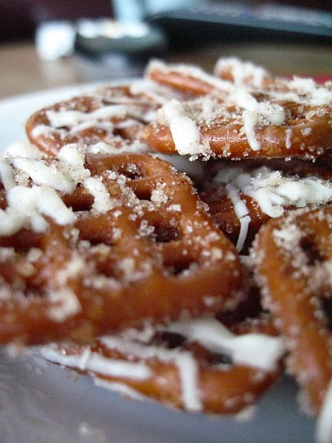 White Chocolate Cinnamon Pretzels  Ingredients:  1 bag of pretzels (16-18 oz) I used the thatch ones because they would catch more chocolate  2/3 cup oil  1/3 cup sugar  1 ½ teaspoon cinnamon  ½ cup cinnamon sugar for sprinkling  1 cup white chocolate chips