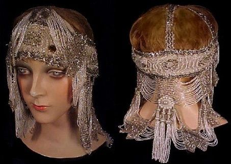 1920's Museum Quality Beaded Flapper Headpiece, with small silver and white beads, beaded bands, large amber-colored glass stones on the headband and beaded tassel at the mid-back, posted by Antique & Vintage Dress Gallery via antiquedress.com