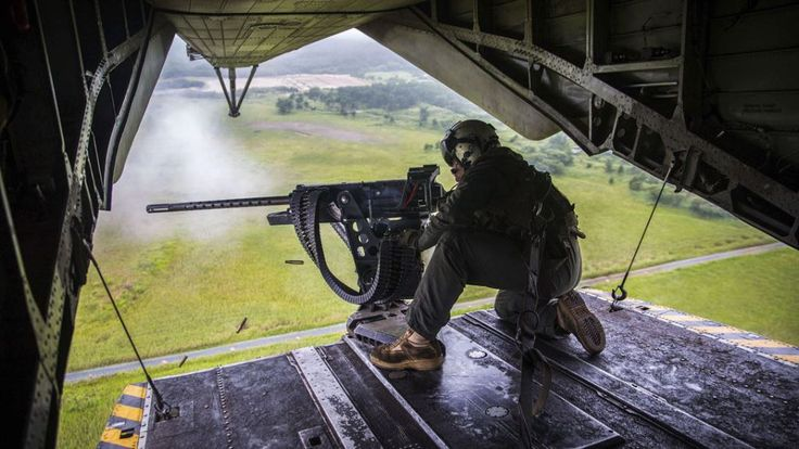 A Marine Corps crew chief fires an M2 .50-caliber machine gun from the back of a CH-53E Super Stallion helicopter near Misawa Air Base, Japan, August 21, 2017, during exercise Northern Viper 17. – US Department of Defense