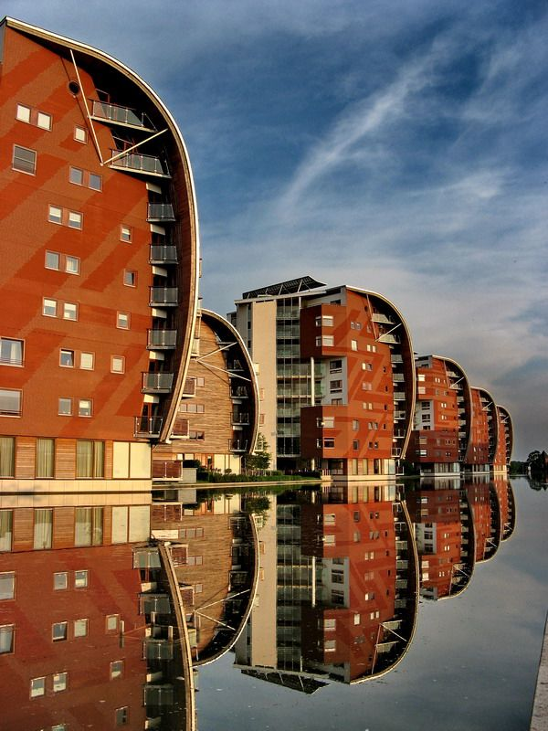 "Netherlands. Photographer Henri Tops: ""Reflections and modern architecture in the evening. You'll find these modern buildings behind the railway station of 's-Hertogenbosch-central. The buildings are part of the famous 'Armada'-project; a row of curved buildings which together look like an armada of tall sailingships with the wind blowing in their sails."""