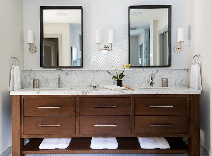 Wanted you to comment on the dark cabinets with the herringbone chevron tile backsplash up the wall.