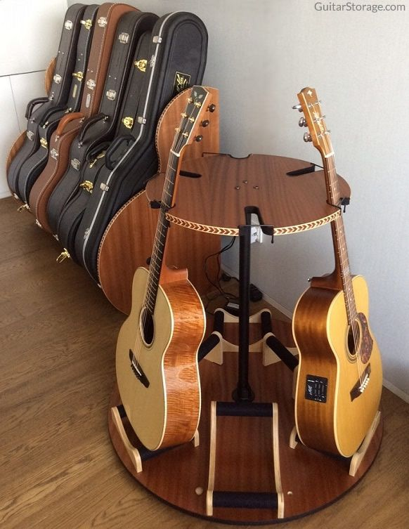 This customer cleaned up their guitar room with the help of our Studio™ Guitar Case Organizers and Carousel Rotating Guitar Stand. Details at https://www.guitarstorage.com