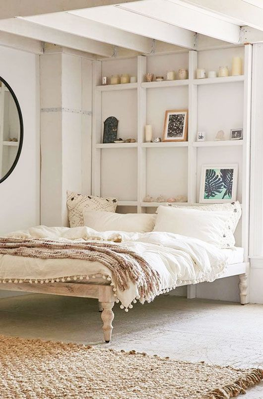 This minimal bed frame would be super easy to make using a simple frame tutorial and recycled legs from an old table.