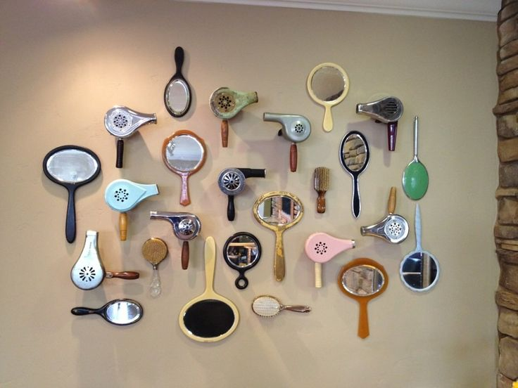 Retro and antique hair dryer collection decorating a salon wall [Photos for Gypsy Rose Salon | Yelp]