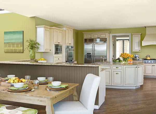 Light, bright green enlivens an open-plan kitchen.
