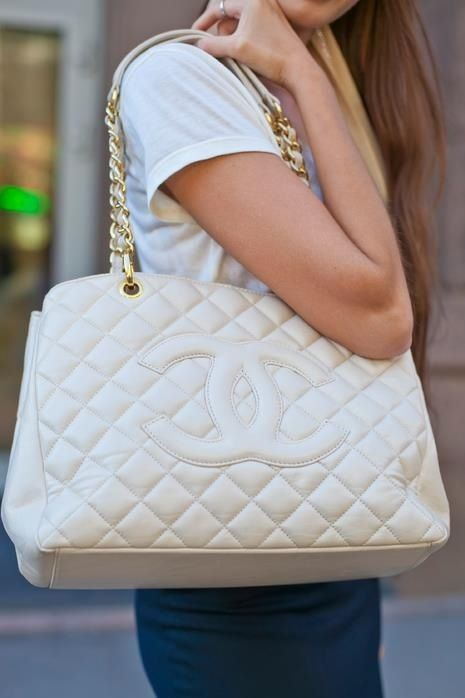 White Chanel bag with gold straps white quilted design with the logo in white very cute  ;)